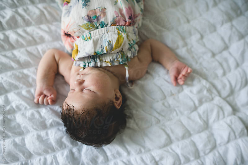 inverted perspective of baby sleeping  by Courtney Rust for Stocksy United