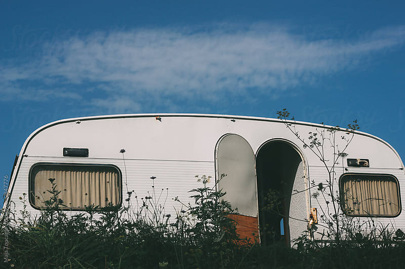 White retro camp house parked on a meadow by Maja Topcagic for Stocksy United