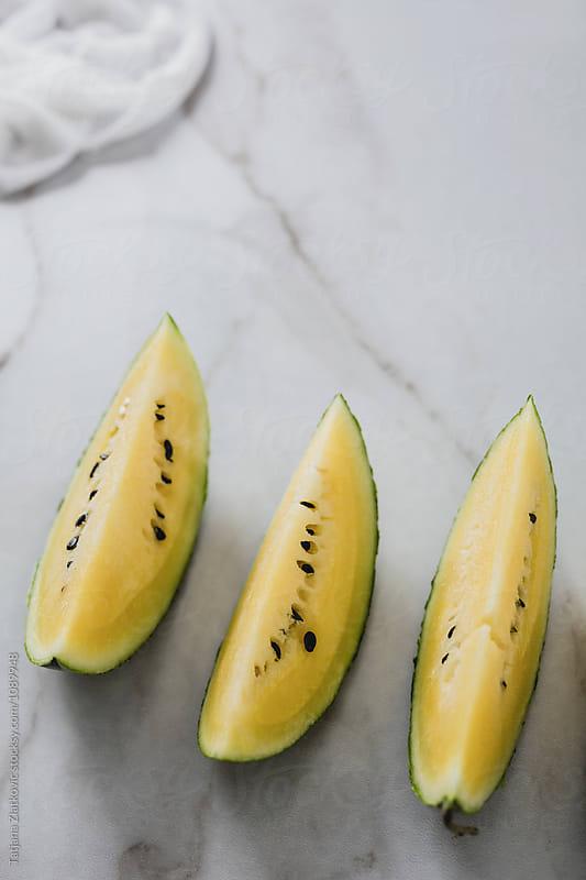 Yellow watermelon by Tatjana Zlatkovic for Stocksy United