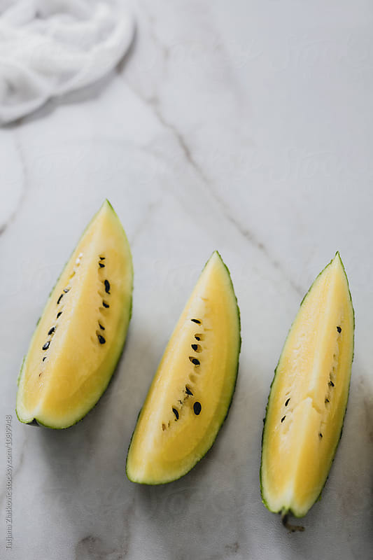 Yellow watermelon by Tatjana Ristanic for Stocksy United