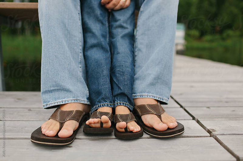 feet of a father and his son by Kelly Knox for Stocksy United
