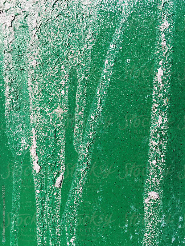 Close up of green metal wall and dripping paint by Paul Edmondson for Stocksy United