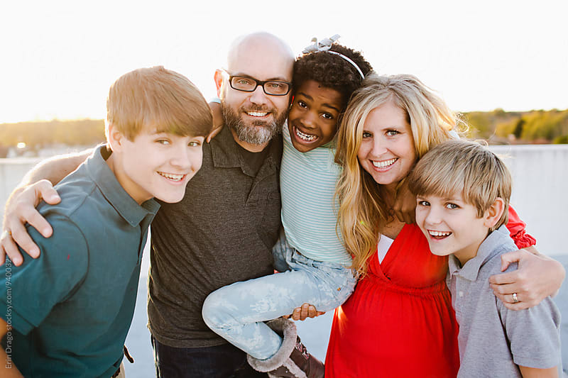 Happy Mixed-Race Family by Erin Drago for Stocksy United