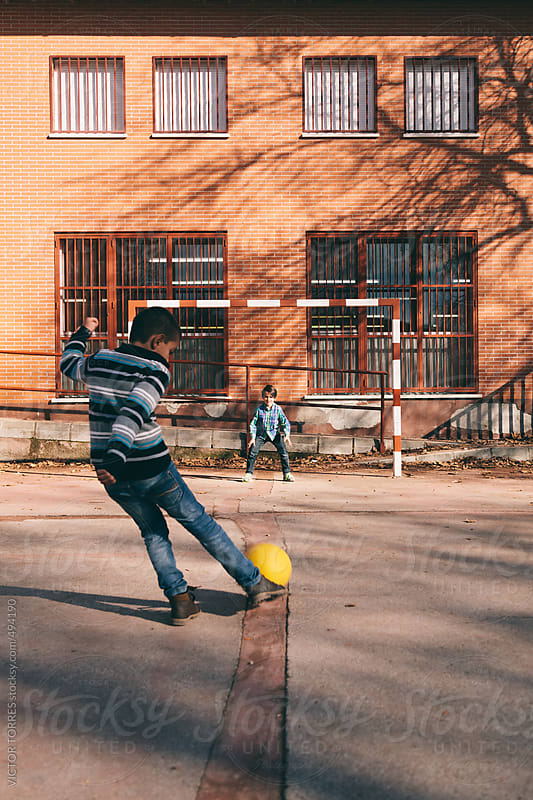 Kids Playing Football at School by VICTOR TORRES for Stocksy United