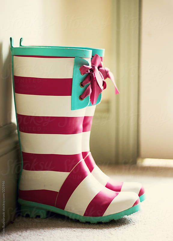 striped wellington boots by Helen Rushbrook for Stocksy United