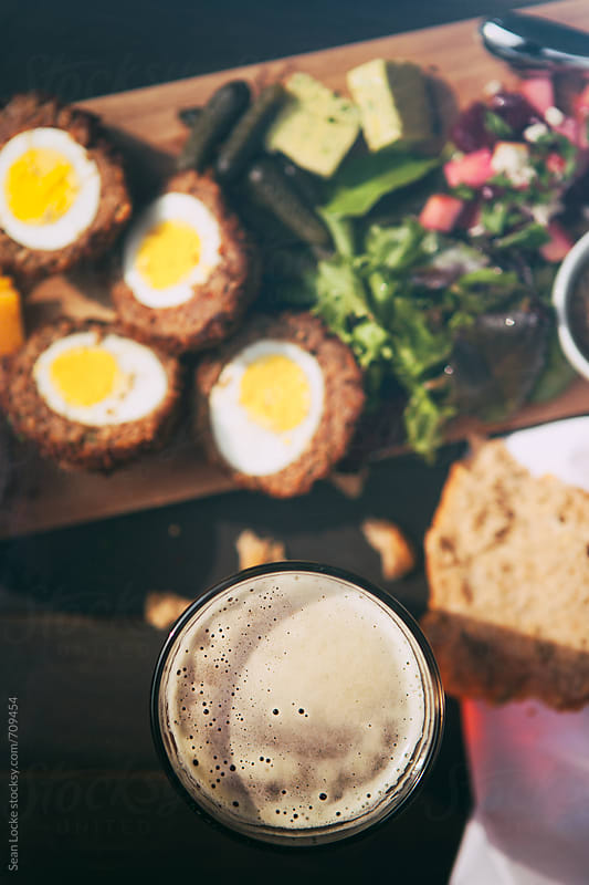 British Ploughman's Plate With Focus On Beer by Sean Locke for Stocksy United