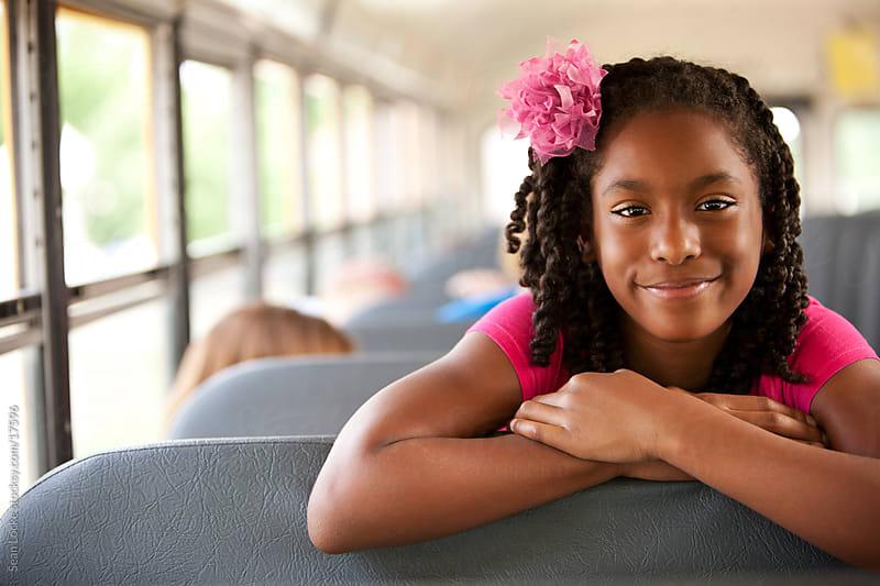 School Bus: Cute African American Girl Looks over Seat by Sean Locke for Stocksy United