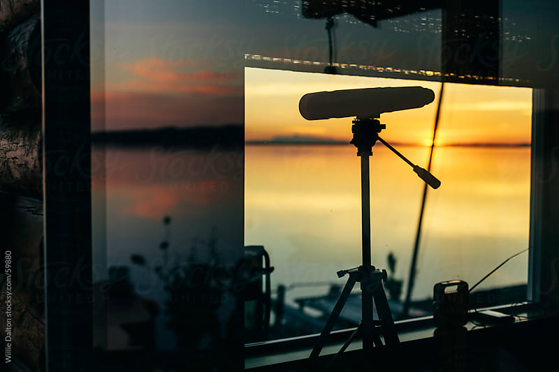 Sunset, Reflection & a Telescope by Willie Dalton for Stocksy United
