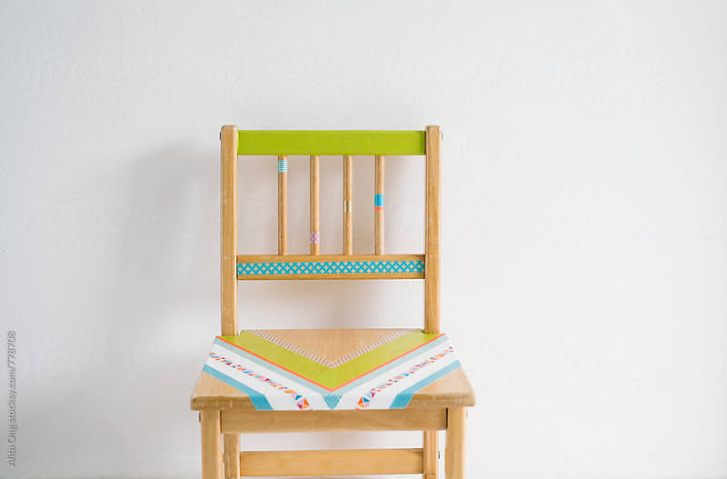 Decorated old kid's chair with Japanese washi tapes by Alita Ong for Stocksy United