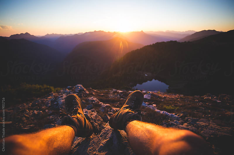 First Person View of Sunset in the Mountains overlooking a secluded lake by Christian Tisdale for Stocksy United
