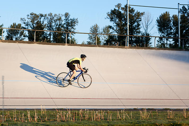 Cyclist training in a velodrome by Suprijono Suharjoto for Stocksy United