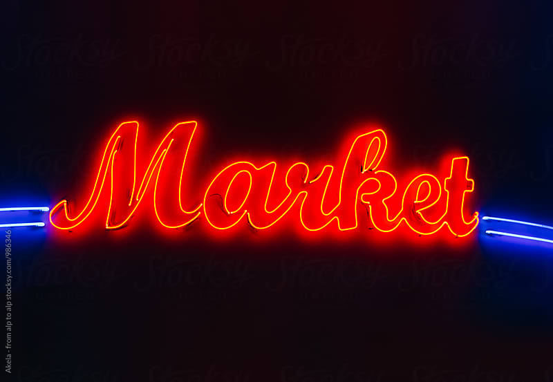 market neon sign on black background by Leander Nardin for Stocksy United