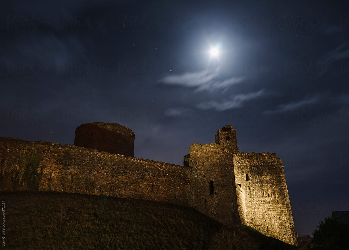Moon Over Kidwelly Castle At Night Wales Uk Stocksy United