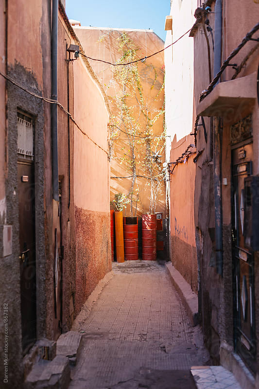 Side street in the medina in Marrakech. by Darren Muir for Stocksy United