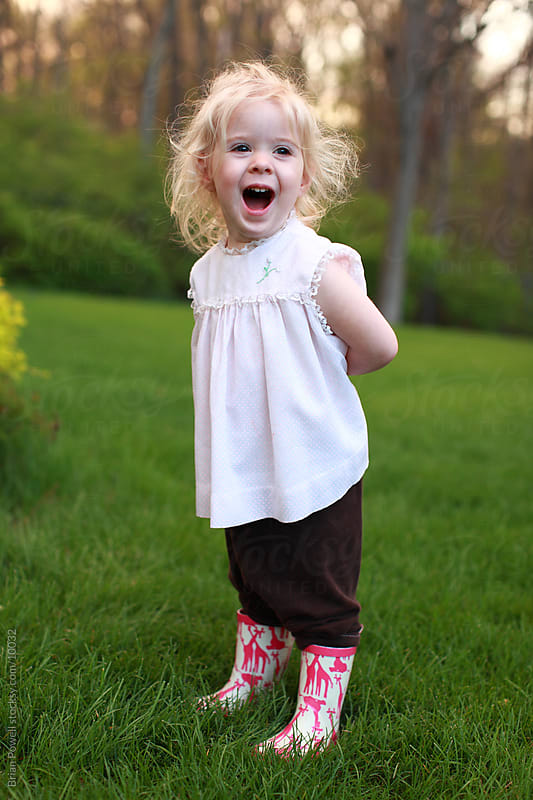 toddler girl laughing by Brian Powell for Stocksy United