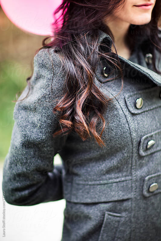 Close-up of girl's dark hair curl by Laura Stolfi for Stocksy United
