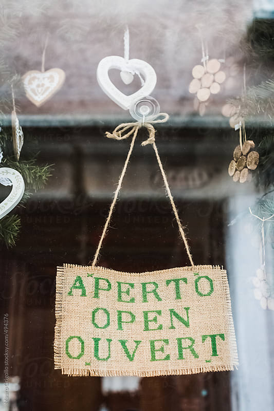 Door of a store with an open sign by Mauro Grigollo for Stocksy United