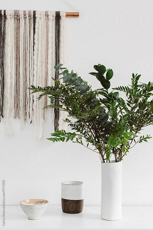 Modern decor and vase of greenery by Carey Shaw for Stocksy United