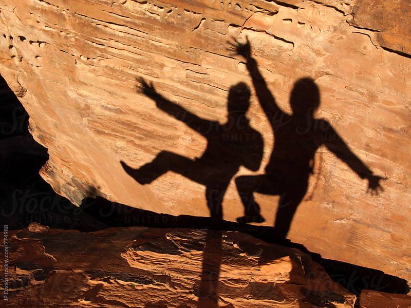 Amusing Shadows of Man and Woman Posing Together in Red Rock Canyon Las Vegas Nevada by JP Danko for Stocksy United
