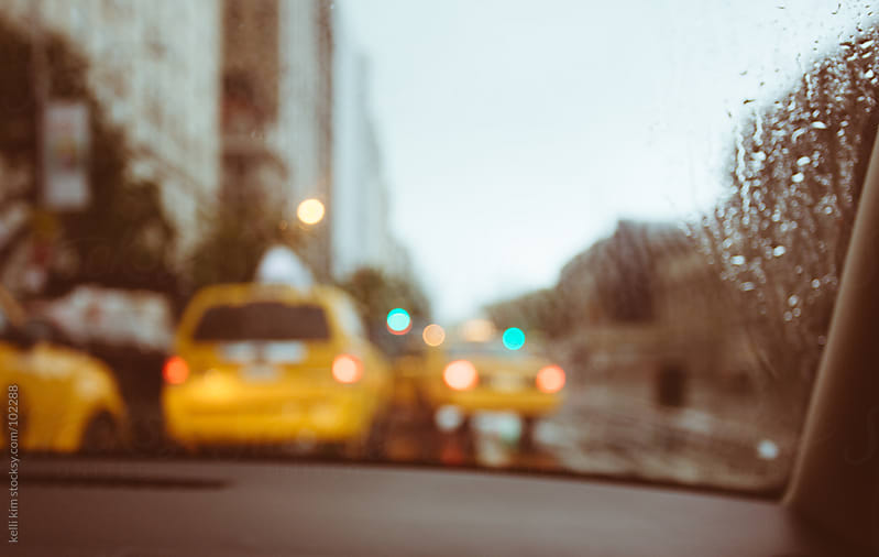 Blurred NYC Street And Taxis Through Rain Covered Windshield by Kelli Seeger Kim for Stocksy United