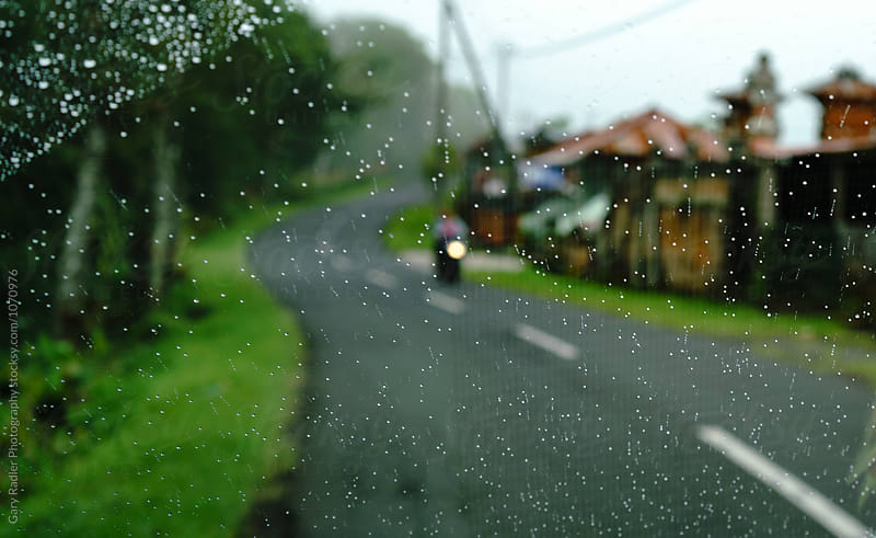 Winding Bali Road shot through a Wet Windscreen by Gary Radler Photography for Stocksy United