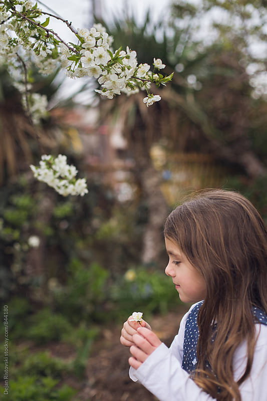 Child exploring spring. by Dejan Ristovski for Stocksy United