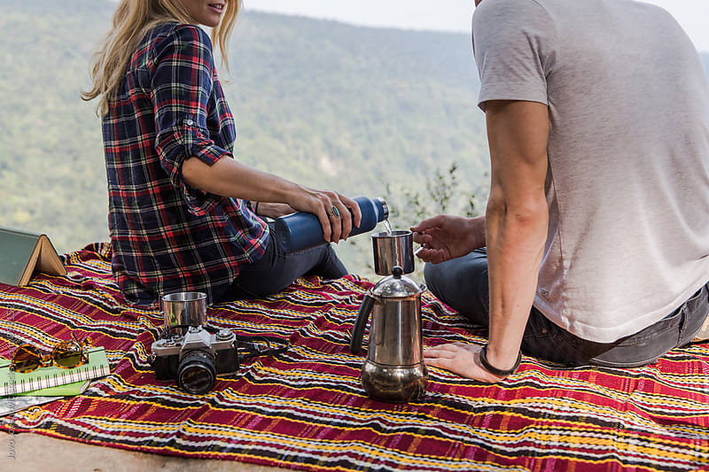 Couple having tea at picnic  by Jovo Jovanovic for Stocksy United