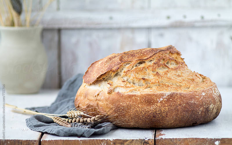 Handmade rustic breads and wheatear by Babett Lupaneszku for Stocksy United