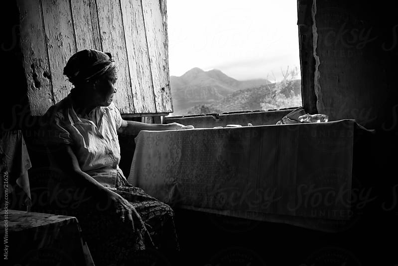 Looking out the Window by Micky Wiswedel for Stocksy United