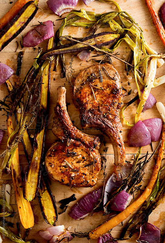 Pork Chops Roasted Vegetables by Jeff Wasserman for Stocksy United