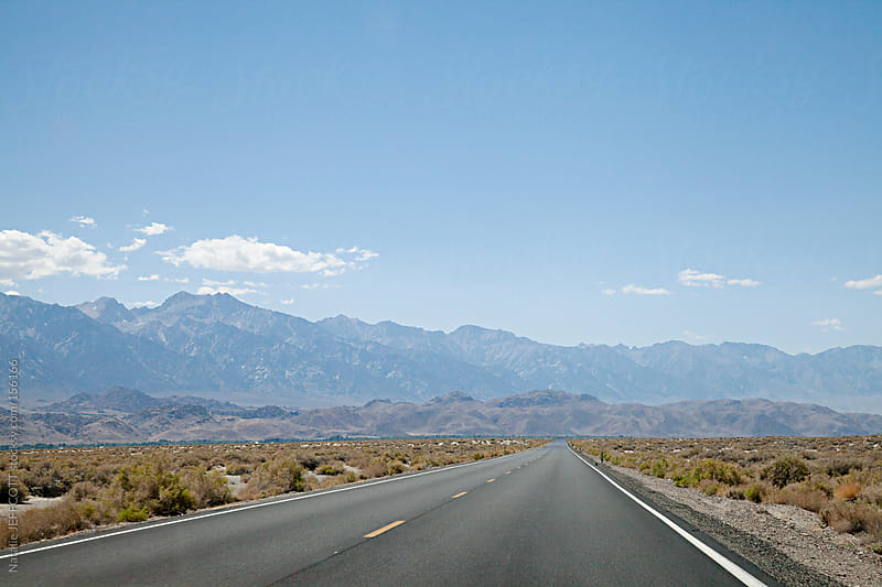 On the road travelling to Death Valley National Park by Natalie JEFFCOTT for Stocksy United