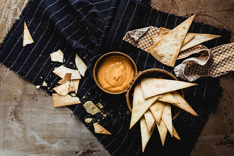 Homemade nacho chips with cheese by Tatjana Ristanic for Stocksy United