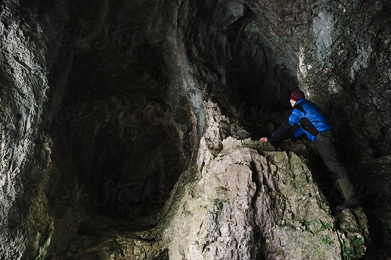 Young male explores the Neolithic caves in Dovedale.  by Liam Grant for Stocksy United