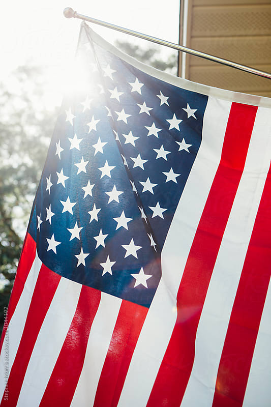 US Flag in Sunlight by Stephen Morris for Stocksy United
