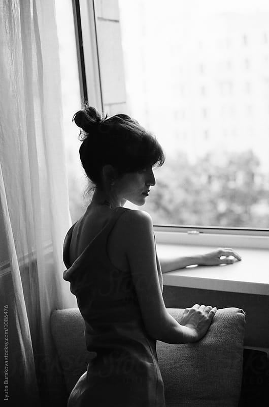 Silhouette of a woman against window by Liubov Burakova for Stocksy United