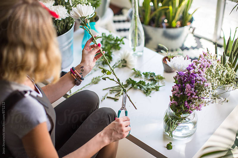 Wooman making beautiful bouquet of flowers cuttings by Jovo Jovanovic for Stocksy United