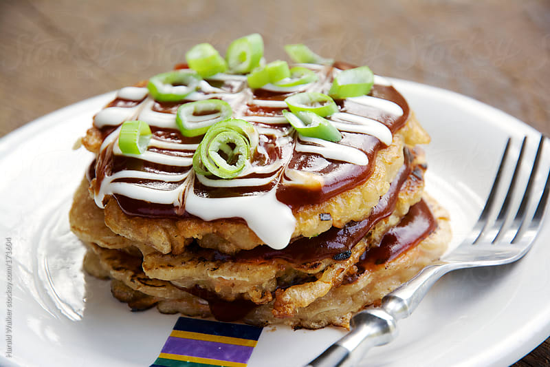 Okonomiyaki - Japanese Cabbage Pacakes by Harald Walker for Stocksy United