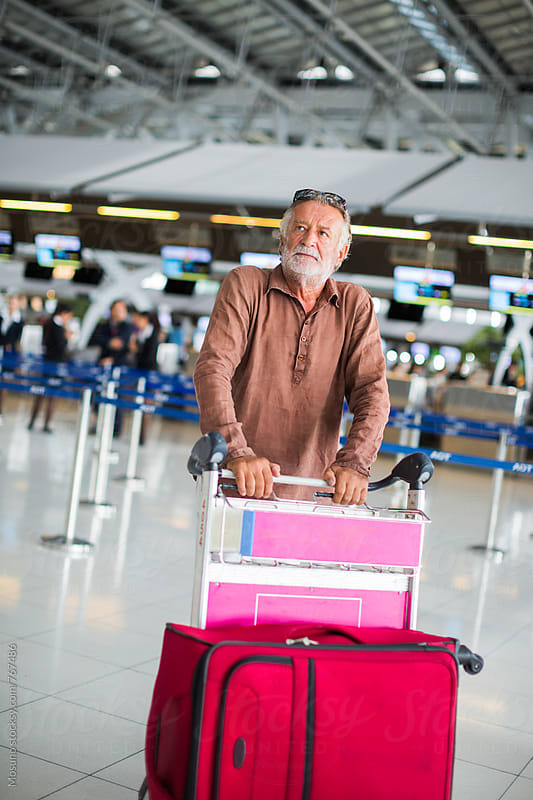 Old Man Going to Check In at the Airport by Mosuno for Stocksy United