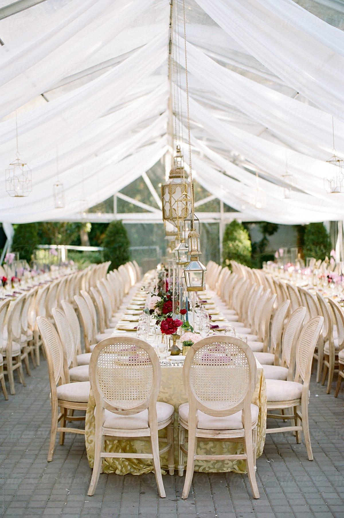 Exotic golden wedding reception dinner by Seth Mourra - Dinner party, Wedding  reception - Stocksy United