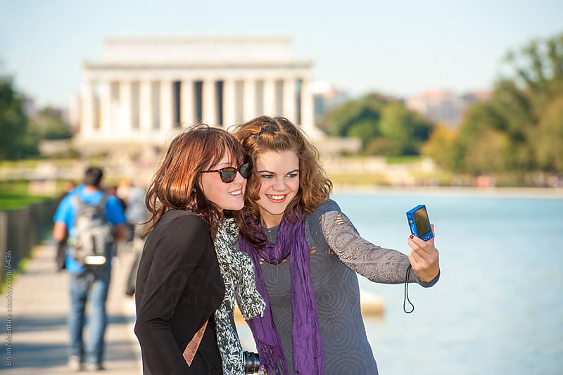 Tourists take photo by Lincoln Memorial with Compact Camera by Brian McEntire for Stocksy United