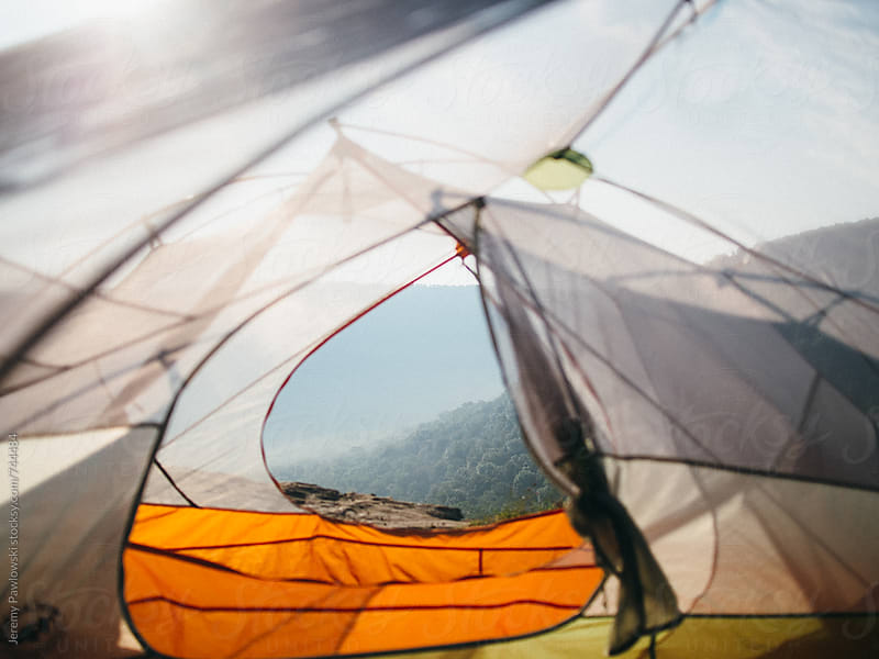 Looking out of tent at mountains. by Jeremy Pawlowski for Stocksy United