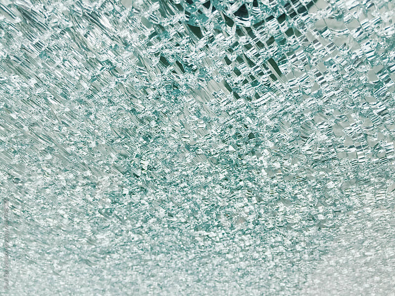 Close up of shattered glass window  by Paul Edmondson for Stocksy United