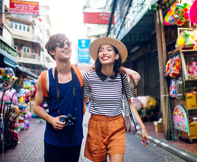 Couple on the Streets of Bangkok by Lumina for Stocksy United