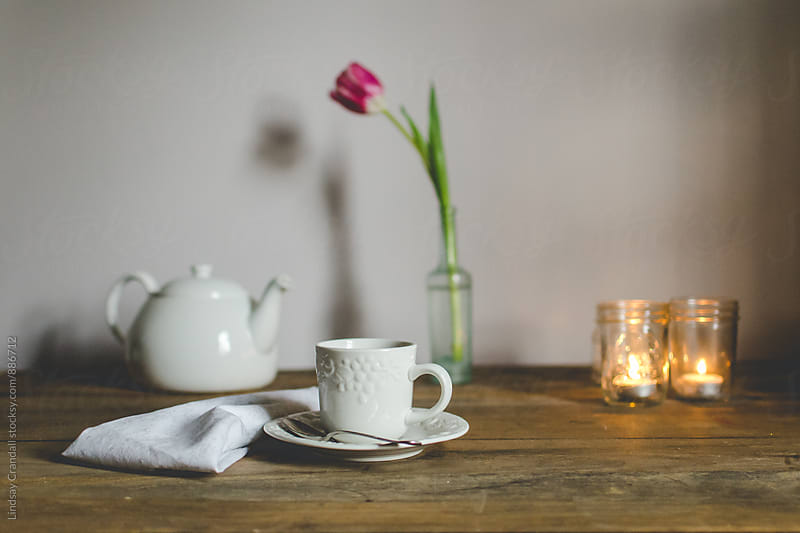 Tea for one, with teapot and flower by Lindsay Crandall for Stocksy United