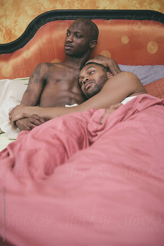Black Gay Male Couple at Home in Bed by Joselito Briones for Stocksy United