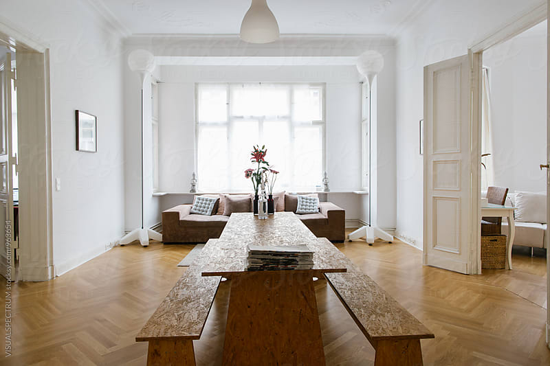 Large Table in Bright Stylish City Apartment Living Room by Julien L. Balmer for Stocksy United
