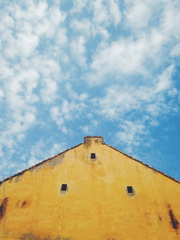 Minimalistic Yellow Building Against the Blue Sky by Aleksandra Jankovic for Stocksy United
