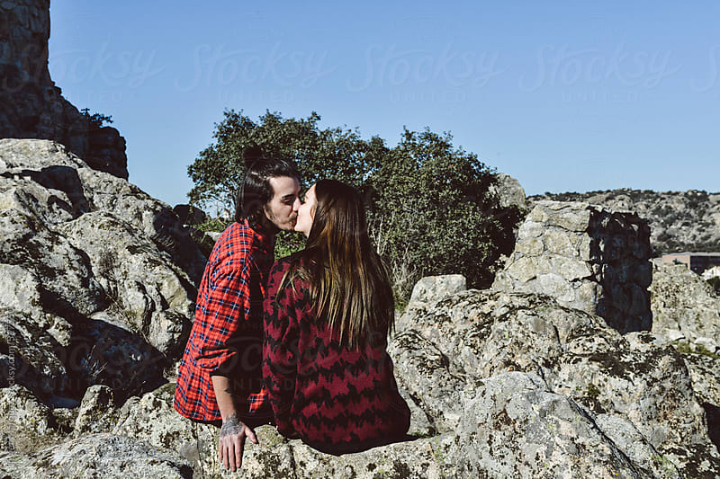 Loving Couple Having Fun in a Nature Setting by Javier Márquez for Stocksy United