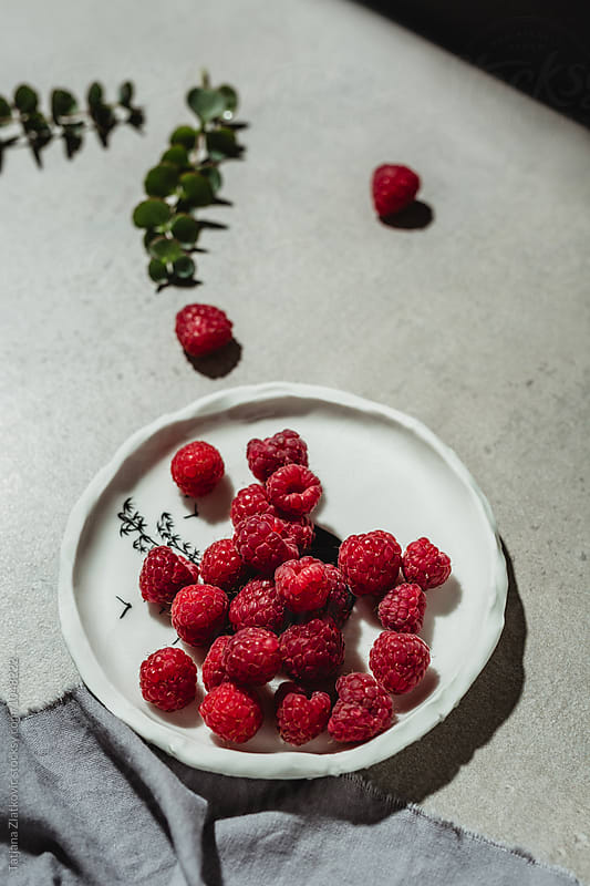 Raspberries by Tatjana Ristanic for Stocksy United