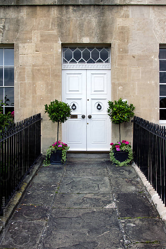Doorway with topiary by Ruth Black for Stocksy United